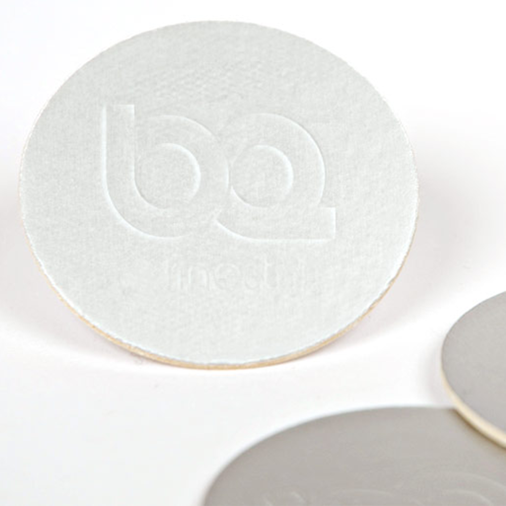 sealing foil with embossed logo